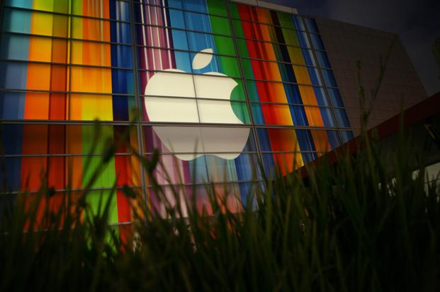 The new direction apparently doesn't foreclose the possibility that Apple might someday build its own car, but it opens the door to partnering with other car companies. Photo: AFP