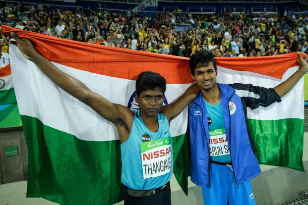 Mariyappan Thangavelu (Left) and Bhati Varun Singh celebrate their gold and bronze medals, respectively, after the men's final high jump during Rio Paralympic Games on 9 September 2016. Photo: AFP