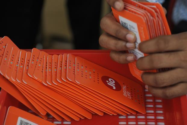 The current subscriber base of Jio is 5 million and Jio SIM cards are only being distributed through Reliance stores. Photo: AFP