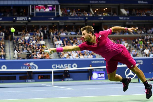 Stan Wawrinka of Switzerland returns a shot to Novak Djokovic of Serbia during their Men's Singles final match of the 2016 US Open on 11 September. Photo: AFP