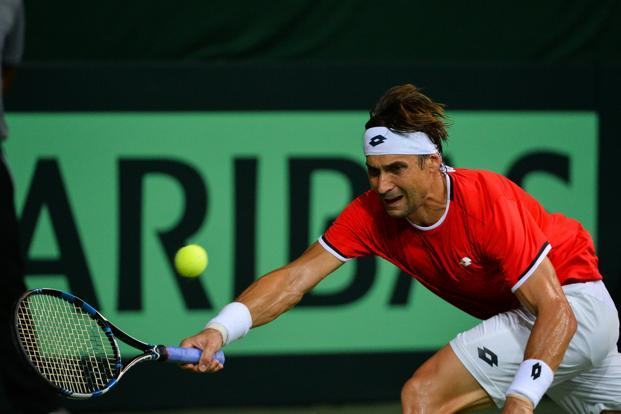Spain's David Ferrer returns the ball to India's Saketh Myneni during their Davis Cup match at RK Khanna Tennis Stadium in New Delhi on 16 September. Photo: AFP