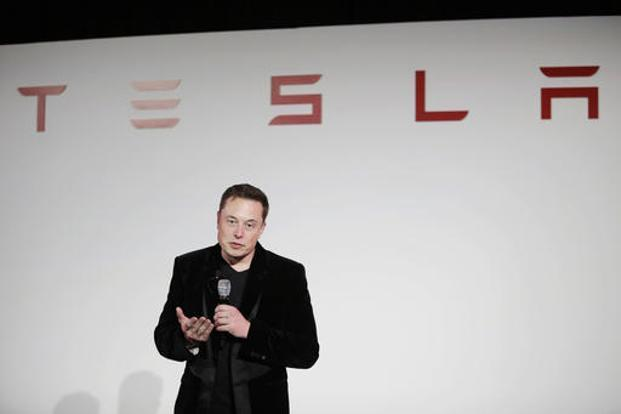 Elon Musk, CEO of Tesla Motors Inc., talks during a news conference at the company's headquarters in Fremont, California. Photo: AP