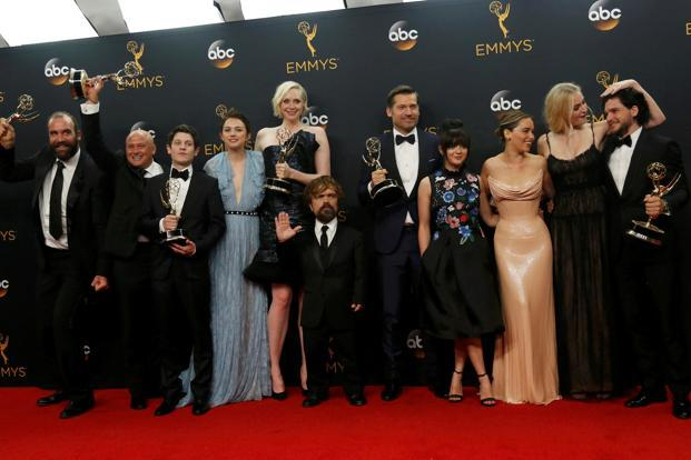 The cast of HBO's 'Game of Thrones' pose backstage with their award for Oustanding Drama Series at the 68th Primetime Emmy Awards. Photo: Reuters