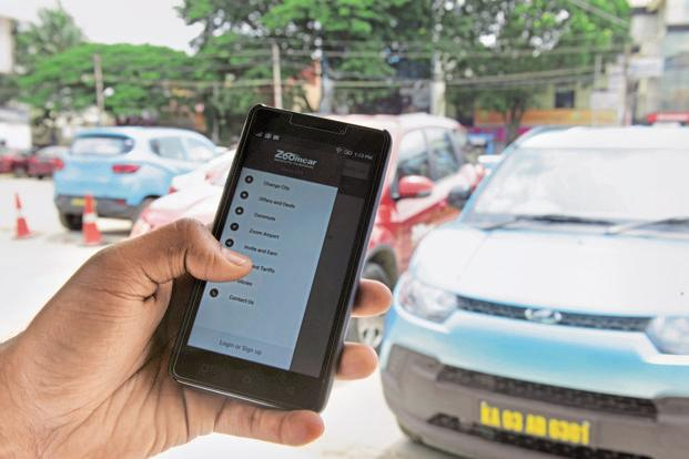 Customers can book a ride and board a car stationed across multiple locations. For a nominal fee, the cars can also be delivered at the customers doorstep. Photo: Hemant Mishra/Mint