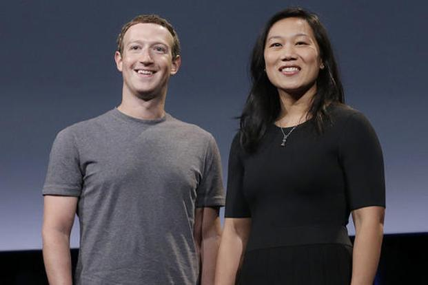 Facebook co-founder Mark Zuckerberg with wife, Priscilla Chan. The Zuckerbergs have committed to give away 99% of their wealth to philanthropic causes in their lifetimes. Photo: AP
