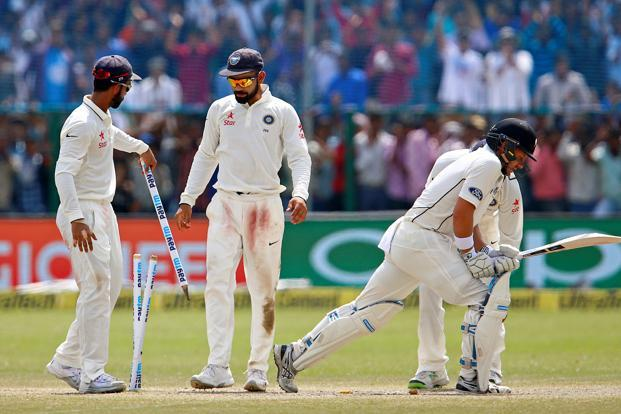 India's Virat Kohli (2nd left) celebrates with teammates after winning the first match in the three test series. Photo: Reuters