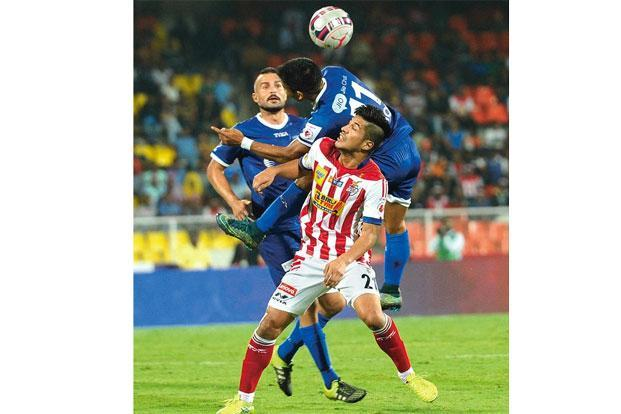 Arata Izumi (in red) during the Indian Super League in Pune in December. Photo: Arijit Sen/Hindustan Times
