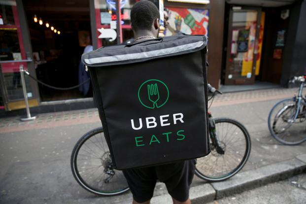The launch of food-delivery service UberEats in Japan will give Uber a slice of a market which almost doubled in 2014 to ¥1.9 trillion. Photo: Reuters