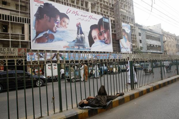 A file photo of a  Pakistani theatre displaying Indian movie poster in Karachi in April 2008. Photo: Reuters