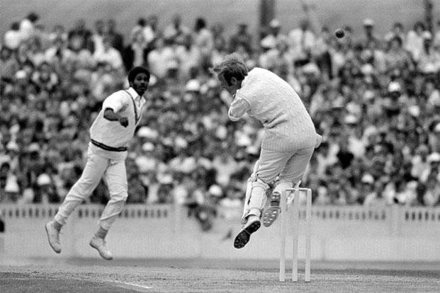 West Indies bowler Michael Holding smashes one into England's Derek Underwood, 1976. Photo: Patrick Eagar