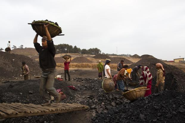India plans to expand coal output to 1.5 billion metric tons by 2020. Photo: Bloomberg