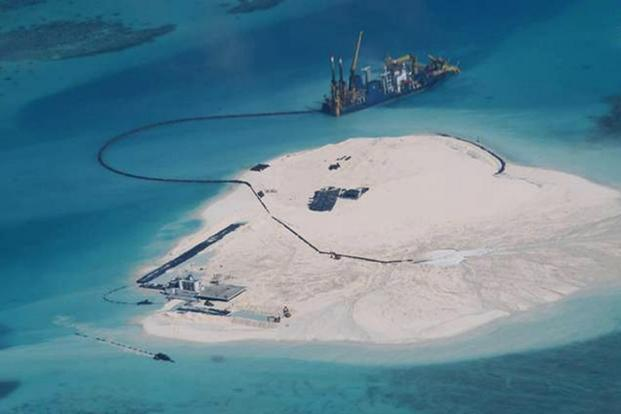 China has been building infrastructure in the disputed islands as it consolidated its hold on the area after an international tribunal quashed its claims over almost all of the SCS. File Photo: AFP/DFA