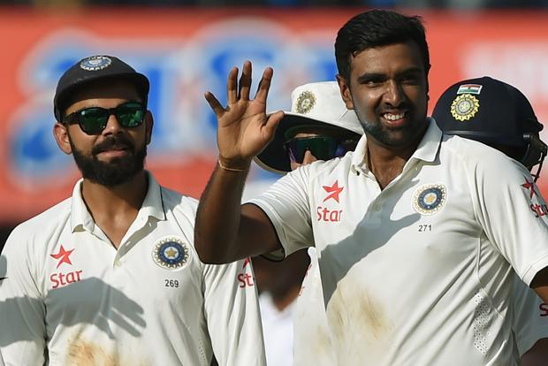 Bowler Ravichandran Ashwin (R) celebrates as captain Virat Kohli (L) watches after taking the wicket of New Zealand batsman Jeetan Patel during the fourth day of third Test cricket match between India and New Zealand in Indore on Tuesday. Photo: AFP