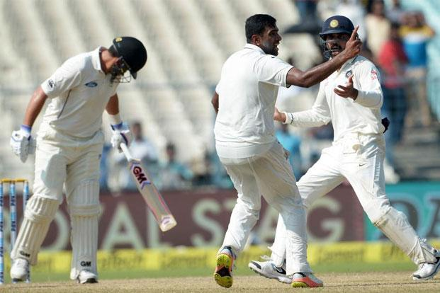 Ravichandran Ashwin takes the wicket of Ross Taylor during the second Test match between India and New Zealand in Kolkata. Photo: Dibyangshu Sarkar/AFP