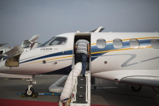 A file photo of an Embraer SA Phenom 100 jet displayed at the Singapore Airshow in February 2014. Photo: Bloomberg