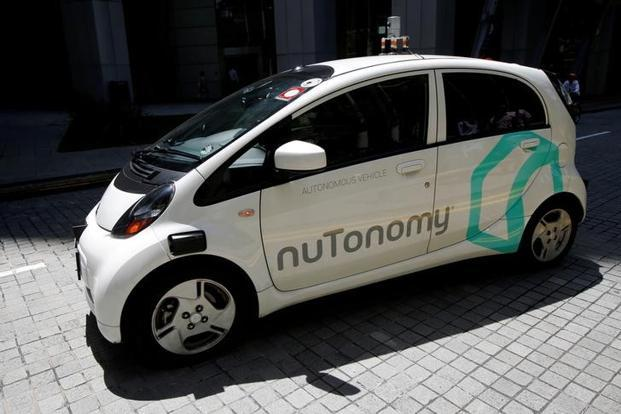nuTonomy, which is developing and testing the technology, said the car was operating with two engineers onboard and travelling slowly. Photo: Reuters