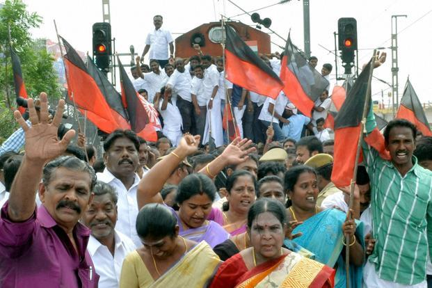 Members of DMK stage a rail-roko protest against the Central government over the Cauvery dispute at the Coimbatore railway station on Monday. Photo: PTI
