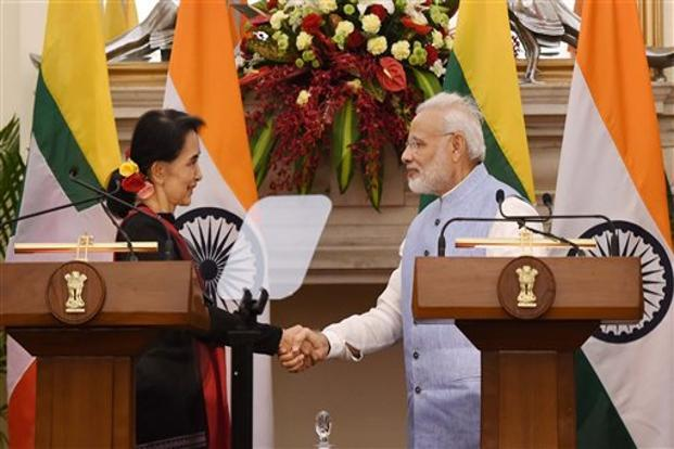 Prime Minister Narendra Modi shakes hands with Myanmar state counsellor and foreign minister Aung San Suu Kyi at Hyderabad House, in New Delhi on Wednesday. Photo: PTI
