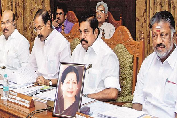 The government released photographs of the cabinet meeting, where Panneerselvam was seen seated with the picture of Jayalalithaa placed on his desk. Photo: PTI