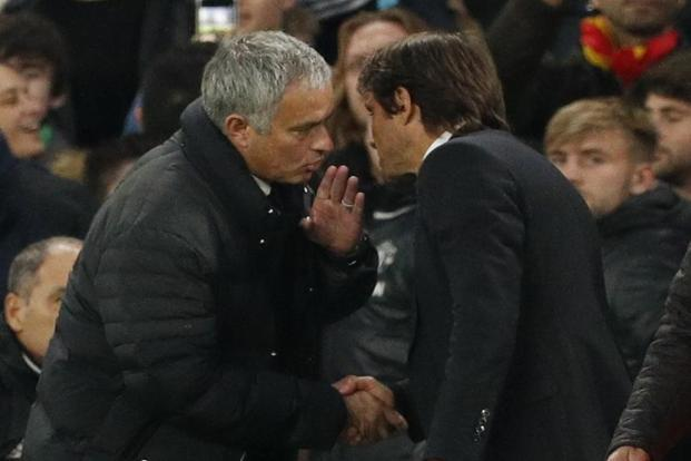 Manchester United manager Jose Mourinho (left) and Chelsea manager Antonio Conte at the end of the match. Photo: Reuters
