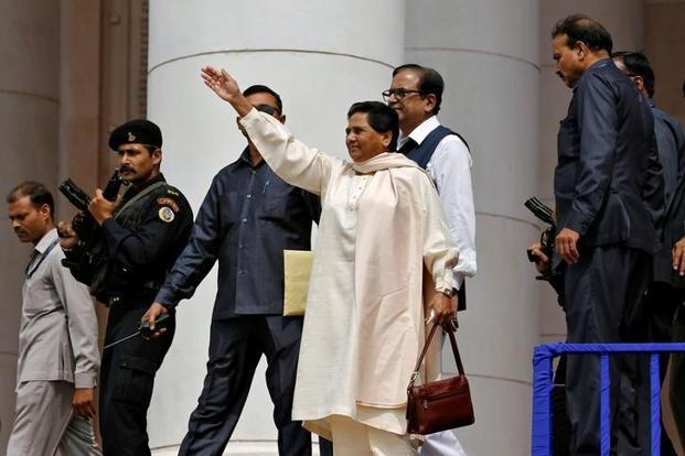 BSP chief Mayawati waves to her supporters during an election campaign rally on the occasion of the death anniversary of Kanshi Ram in Lucknow. Photo: Reuters