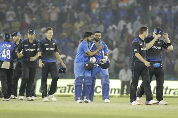 India's Virat Kohli, center right, and teammate Manish Pandey celebrate their victory over New Zealand in the third ODI cricket match in Mohali on Sunday. Photo: AP