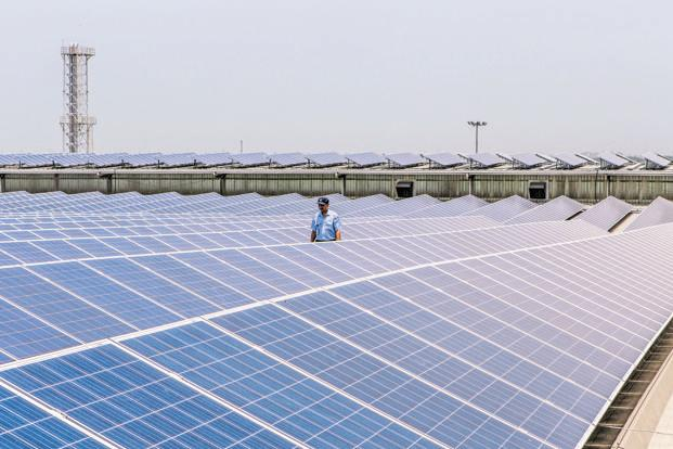 India needs as much as $200 billion to meet its target of installing 100GW of solar power and 60GW of wind power by 2022. Photo: Bloomberg
