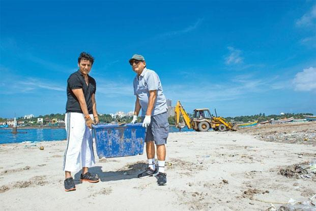 Afroz Shah (left), who kick-started the beach clean-up