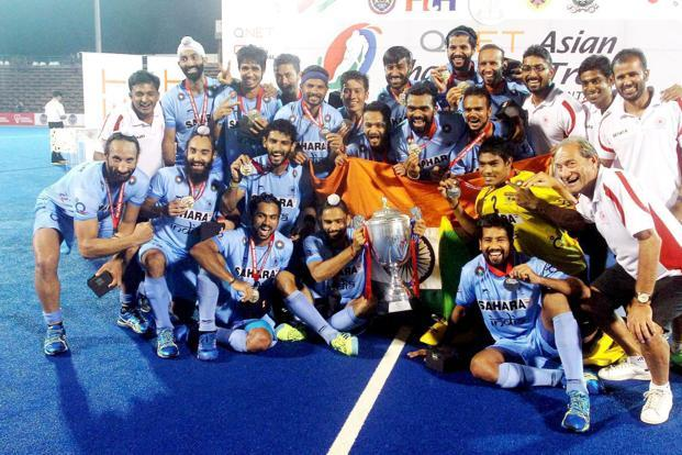 Indian hockey players pose with the Asian Champions Trophy after they beat Pakistan in the final in Kuantan, Malaysia, on Sunday. Photo: PTI