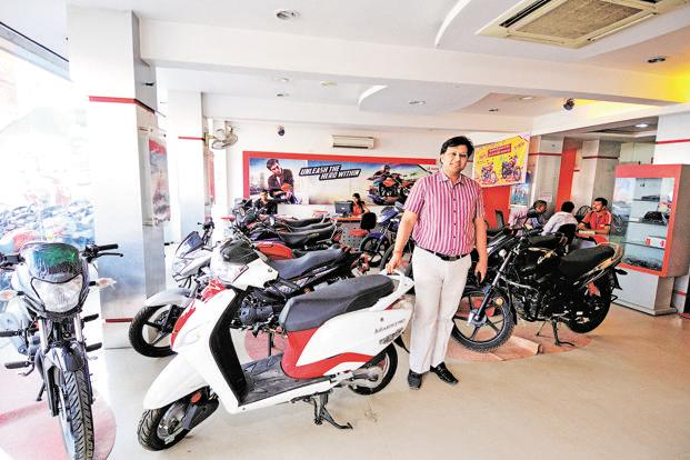 Kushagra Agrawal inherited his father's two-wheeler dealership in Varanasi. Photo: Priyanka Parashar/Mint