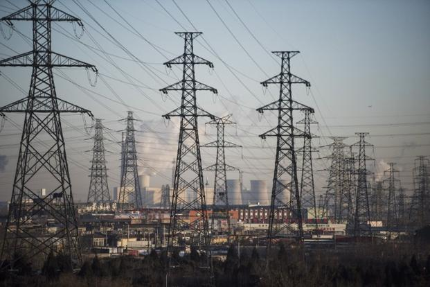 Power plant and electric lines on the outskirt of Beijing. Photo: AFP