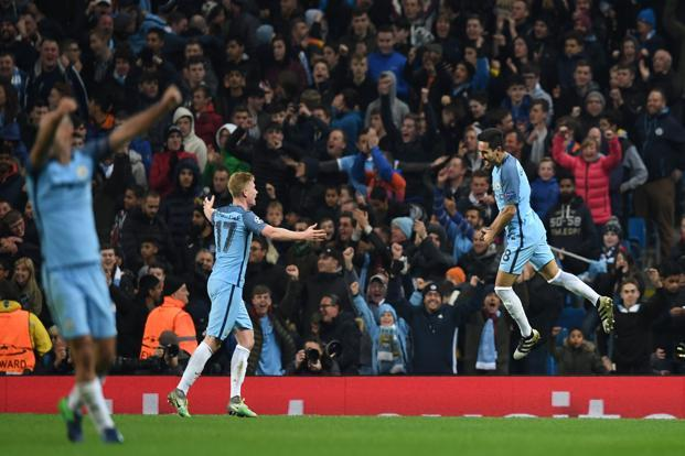 Manchester City's Ilkay Gundogan (right) celebrates scoring his team's third goal during the Champions League group C football match between City and Barcelona on 1 November, 2016. Photo: Paul Ellis/AFP