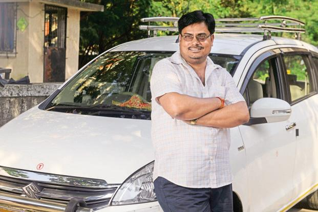 After joining Meru as a driver nine years ago, Vijay Pandey (above) now owns two cars and has employed a driver of his own. Photo: Abhijit Bhatlekar/Mint