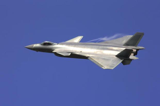 The J-20 stealth fighter flies at the China's International Aviation and Aerospace Exhibition in Zhuhai on Tuesday. Photo: AP