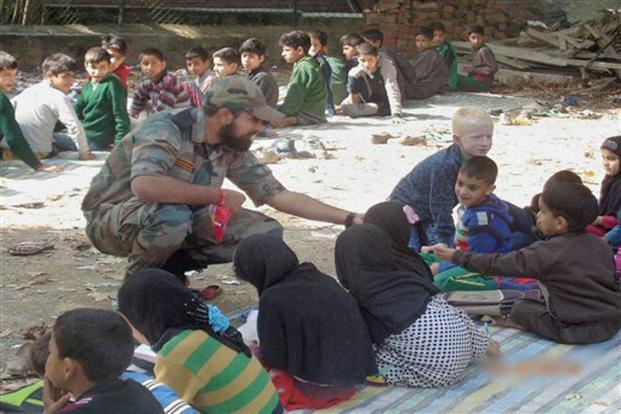 A jawan providing free coaching to students during operation 'School Chalo' by the Indian Army at Awantipora in South Kashmir. The signals from Kashmir are clear. The separatists are preventing children from going to school so that they can use them for their own designs. School-going children nurture dreams of a rosy future: they don't throw stones at the Army.  Photo: PTI
