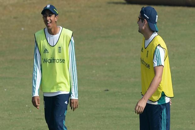 England's Haseeb Hameed (L) with captain Alastair Cook during a training session at the Brabourne Stadium in Mumbai. Photo: AFP
