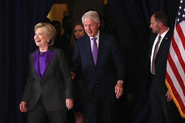 Hillary Clinton, accompanied by her husband former President Bill Clinton, takes the stage to concede the presidential election on Wednesday. Photo: AFP
