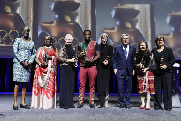 Ethiopian journalist Dagim Zinabu Tekle (4th from left) becomes the first man to receive IOC's Women and Sport Awards. Photo: Twitter@iocmedia