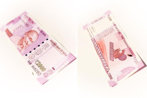 The intaglio printed Gandhi is much smaller than before, and at the back of the note, in addition to the Mangalyaan, there is also a new strip of animal motifs. Photo: Anik Biswas/Mint