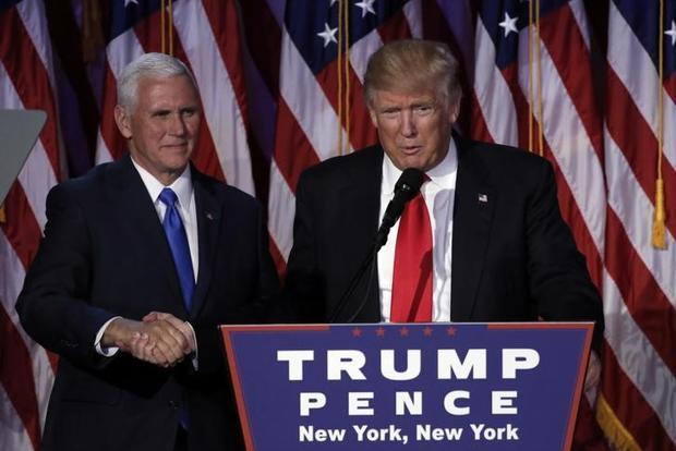 US President-elect Donald Trump and running mate Mike Pence address their election night rally in Manhattan, New York on 9 November. Photo: Reuters