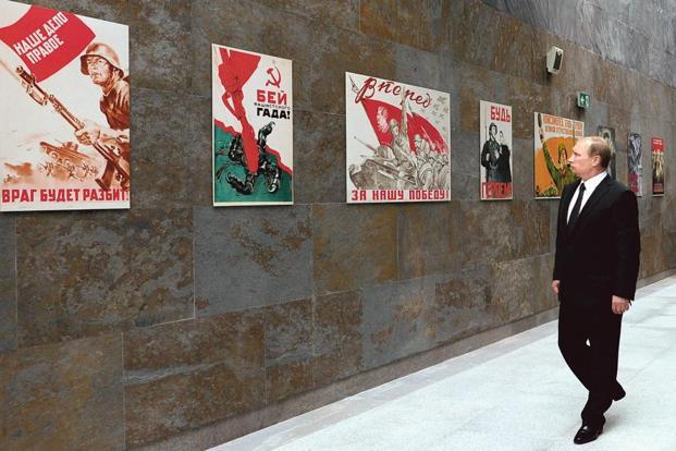 Russian President Vladimir Putin looking at Soviet World War II posters at the State Museum of the Great Patriotic War in Minsk, Belarus. Photo: AFP