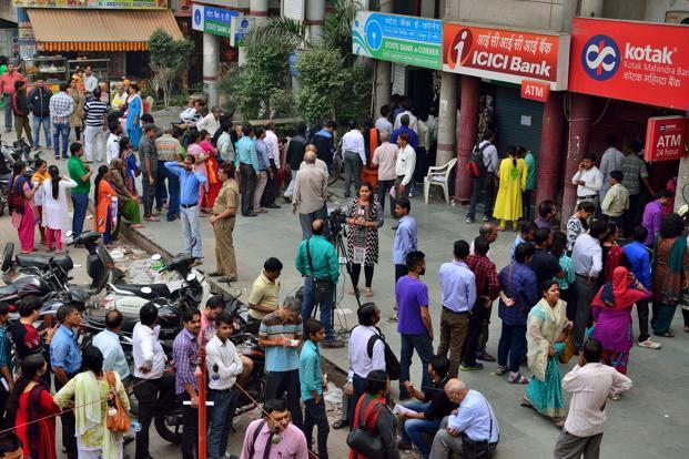 Many banks took a hammering in the share market as they ran out of the new notes and cash machines ran dry, leaving many who queued for hours out of money. Photo: Pradeep Gaur/ Mint