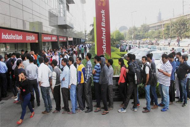 Tuesday's withdrawal of Rs500 and Rs1,000 notes, aimed at curbing corruption and counterfeit currency, has sparked long lines of people looking to exchange their worthless notes. Photo: PTI