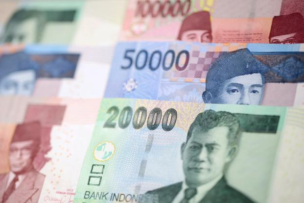 The Indonesian rupiah led declines in Asian currencies as sentiment toward emerging-market assets soured on speculation a Donald Trump administration will enforce protectionist trade policies. Photo: Bloomberg