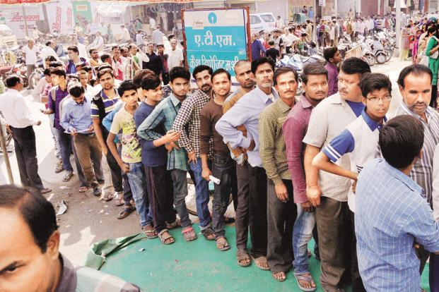 There have been long queues at bank branches and unavailability of cash at ATMs. Photo: PTI