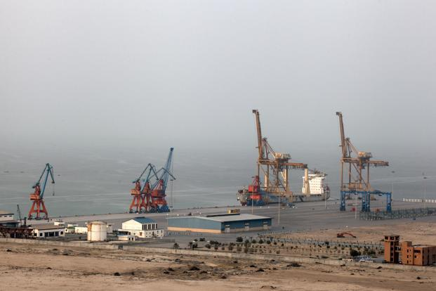 A cargo ship sits berthed next to a crane at Gwadar port in Baluchistan, Pakistan. Photo: Bloomberg