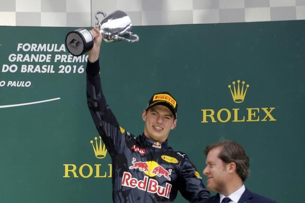 Red Bull's Max Verstappen of the Netherlands celebrates after finishing third in the race. Photo: Reuters