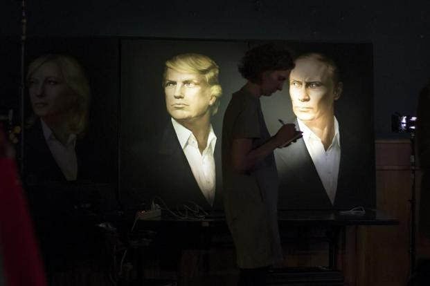 Portraits of US president-elect Donald Trump and Russian president Vladimir Putin in the Union Jack pub in Moscow. Photo: AFP