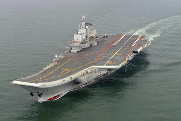 Liaoning carrier is seen as to put more muscle behind the Communist giant's increasing assertive moves in the South China Sea. Photo: AP