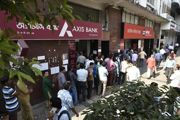 Cash-strapped people were seen waiting in queues in towns and cities as most of the ATMs ran out of cash within hours after being stocked. Photo: Indranil Bhoumik/Mint